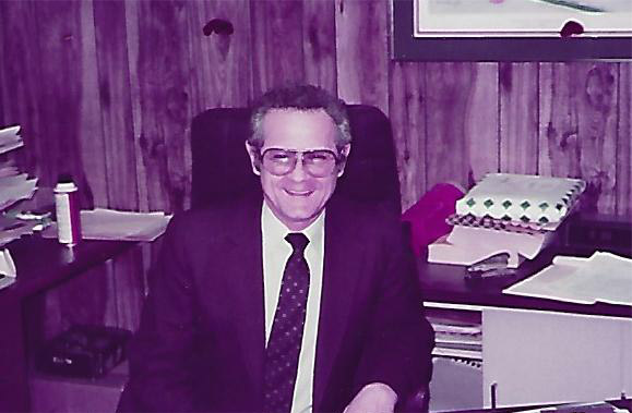 Bud Koloski at his desk, Park Printing Twin Cities
